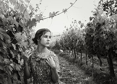 Girl in Vineyard Black and White - p1503m2015856 by Deb Schwedhelm