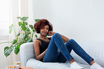 Woman relaxing on sofa - p312m1556873 by Susanne Kronholm