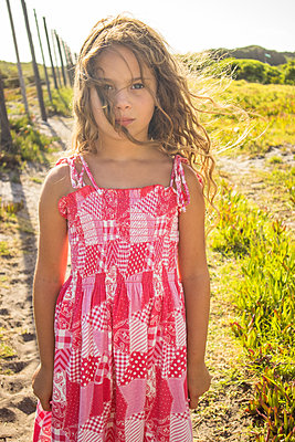 Little girl in red summer dress - p1640m2246114 by Holly & John