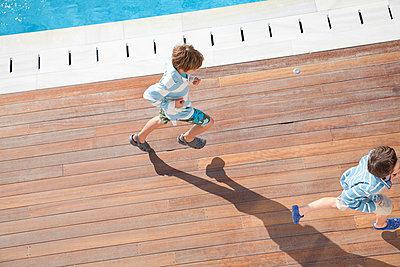 Two boys running, aerial view - p42912249f by Ashley Jouhar