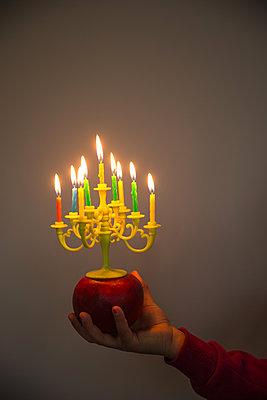 Birthday candles on an apple - p1231m1525109 by Iris Loonen