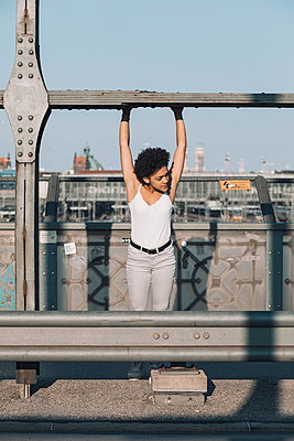 Female teenager on bridge - p728m2038817 by Peter Nitsch