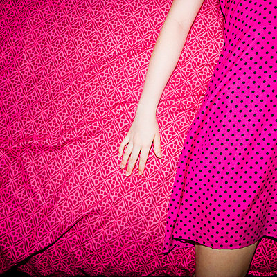 Pink dress on pink cover - p4262994f by Tuomas Marttila
