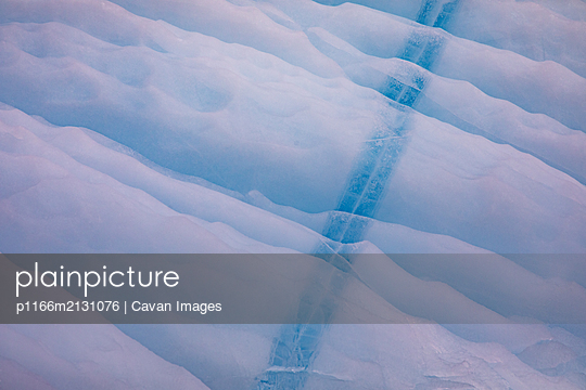 Textures and lines in blue iceberg, Torngats Mountains National Park - p1166m2131076 by Cavan Images