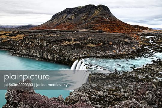 Waterfall on rocky coast, Iceland - p1643m2229393 by janice mersiovsky