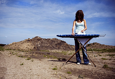 Ironing on the countryside - p1670m2253294 by HANNAH
