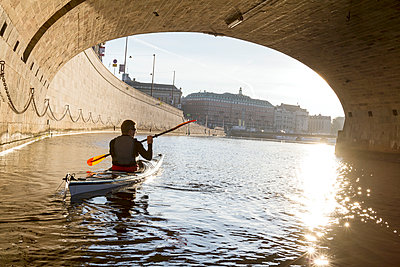 Man kayaking on sea - p312m1103630f by Henrik Trygg