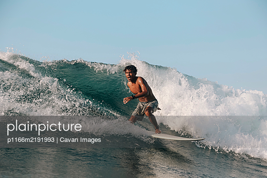 Surfer on a wave, Lombok, Indonesia - p1166m2191993 by Cavan Images