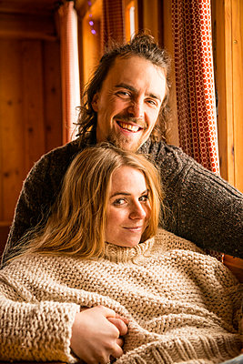 Couple in a mountain cabin - p1142m1035003 by Runar Lind