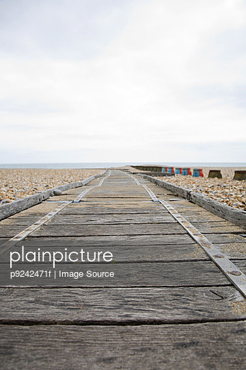 Wooden path leading to sea - p9242471f by Image Source
