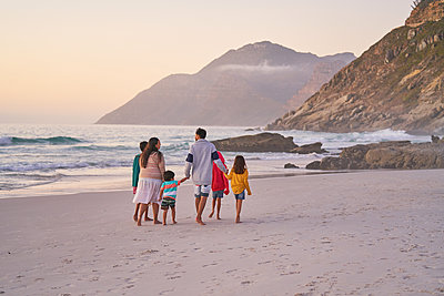 Family walking on ocean beach, Cape Town, South Africa - p1023m2200854 by Trevor Adeline
