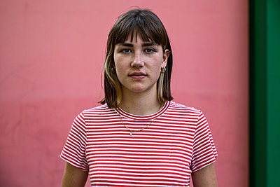 Young woman in stripy shirt - p294m2207532 by Paolo