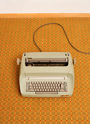 A typewriter centered on a retro carpet - p3010599f by fStop