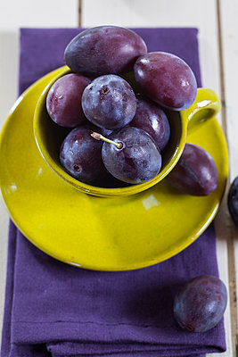 Plums in a cup - p300m1028960f by Susan Brooks-Dammann