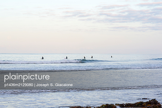 Surfers in the Pacific Ocean from Tourmaline Beach. San Diego, CA. - p1436m2129080 by Joseph S. Giacalone