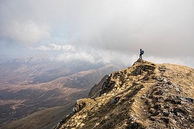 Woman on top of Marsco, Glen Sligachan, Isle of Skye, Scotland - p429m1227088 by Adam Seward