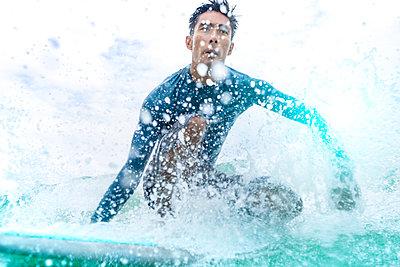 Surfer in action, Pagudpud, Ilocos Norte, Philippines - p429m2075469 by dotdotred