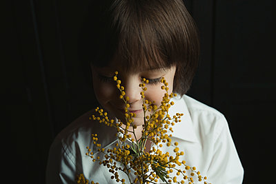 Boy with flowers - p1476m1564097 by Yulia Artemyeva