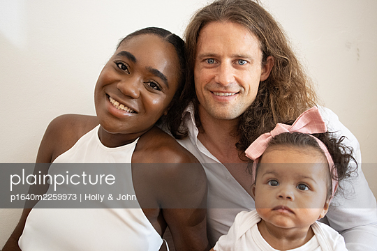 Multi ethnic family with toddler girl - p1640m2259973 by Holly & John