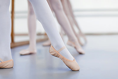 Close up of ballet dancers' feet - p42916228f by Hybrid Images