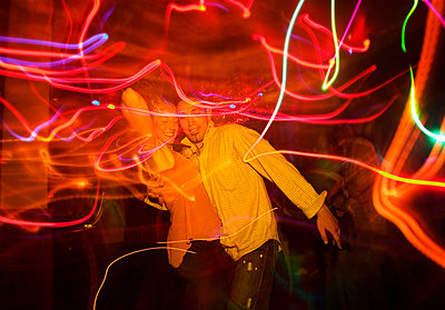 Couple dancing together at nightclub - p301m926778f by Sven Hagolani