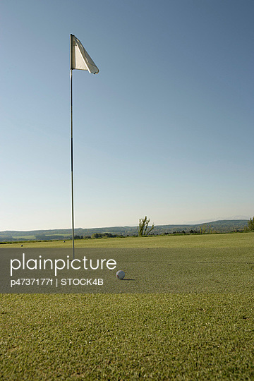 Golf flag and ball