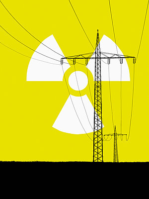 Nuclear power sign in sky with electricity pylons in foreground  - p301m714532f by Malte Mueller