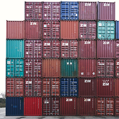 Stacked cargo containers - p1696m2296595 by Alexander Schönberg