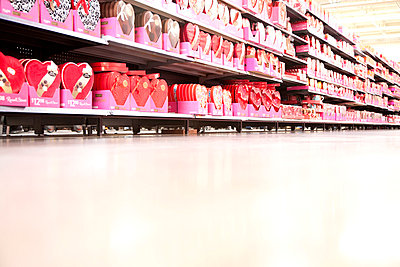 A supermarket store aisle filled with various Valentine's Day's boxes of chocolate - p301m799858f by Frederick Bass