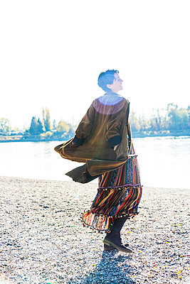 Woman twirling by Rhine River, Strandbad, Mannheim, Germany - p429m2074426 by Jens Luebkemann