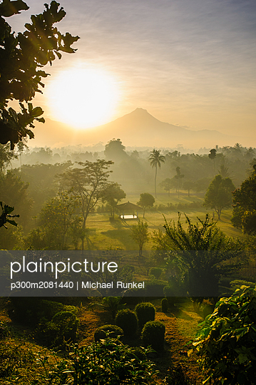 Indonesia, Java, early morning view from the Borobudur Temple Complex on the scenery around - p300m2081440 by Michael Runkel