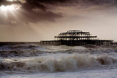 Burnt down jetty in Brighton during windstorm - p2686355 by James Wadey
