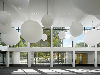 Hanging globes in entrance to Fielden Campus, West Didsbury, Manchester, Greater Manchester. - p855m664538 by Daniel Hopkinson