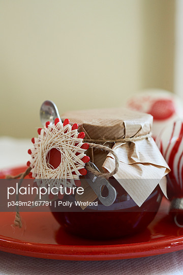 Jam and spoon with brown paper tied with string - p349m2167791 by Polly Wreford