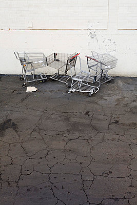 Abandoned shopping carts in a parking lot - p30119151f by Patrick Strattner