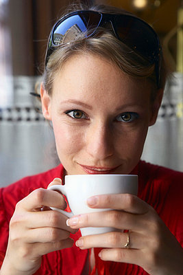 Woman having a cup of coffee. - p4291019f by Karan Kapoor