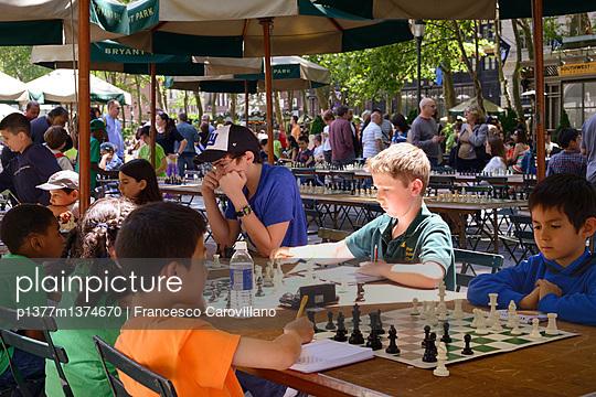 Kids playing chess - p1377m1374670 by Francesco Carovillano