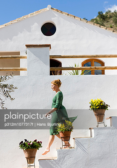 Stairs on a whitewashed house Spain. - p312m1077317f by Hans Bjurling