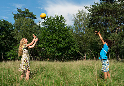 Kids play in the woods - p1132m1152777 by Mischa Keijser