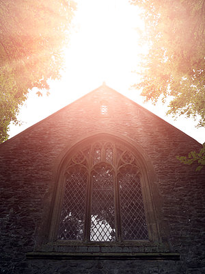 Historic church with arched window at sunrise - p1280m2220204 by Dave Wall