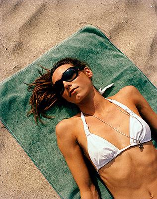 A Scandinavian woman laying sunbathing Thailand - p312m1076697f by Nicho Sodling