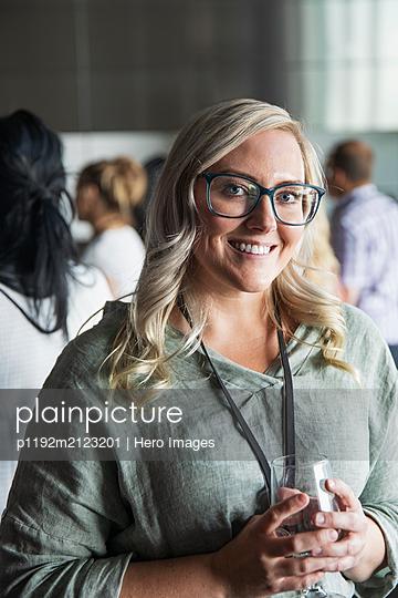 Portrait confident businesswoman at conference - p1192m2123201 by Hero Images