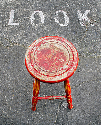 Stool on sidewalk - p1125m917348 by jonlove