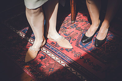 Women's shoes on carpet - p1150m1194434 by Elise Ortiou Campion