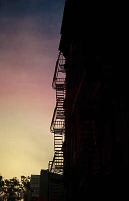 Fire escape in New York at night - p1248m1462109 by miguel sobreira