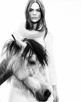Woman and white horse - p548m911635 by Fred Leveugle
