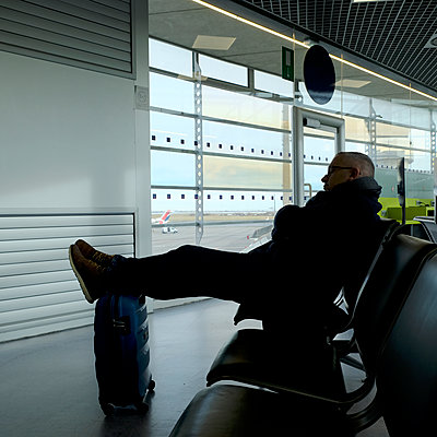 At the airport - p1105m2059717 by Virginie Plauchut