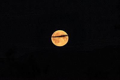 Full moon with cloud - p1455m2204457 by Ingmar Wein