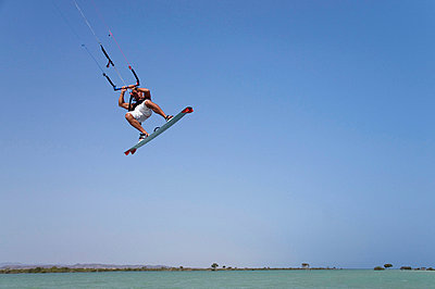 Egypt, The Red Sea, Kitesurfer in midair - p3008406f by Gerald Nowak
