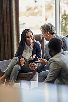 Business people having a meeting in hotel lobby - p300m2171380 by Zeljko Dangubic